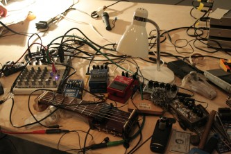 Keith Rowe's 'guitar' set up circa 2008 with pedals, objects, wires and mixer
