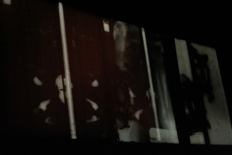 Projection of black and white images, distorted and layered
