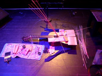 Kazuo Imai's guitar prepared with sticks and various objects