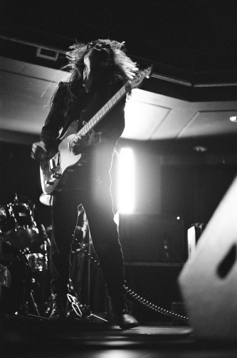 Keiji Haino playing an electric guitar with head thrown back at MLFC 05