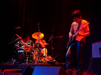 Kyoaku No Intention on stage playing drums and guitar at MLFC 05