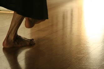 two feet on or near a wooden floor