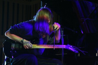 Stefan Jaworzyn playing a guitar with a metal rod at MLFC 07