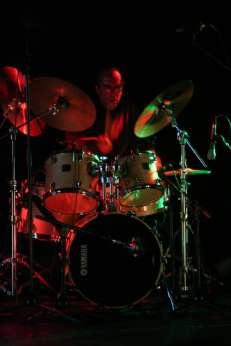 Jackson Krall behind a drum kit at MLFC 07