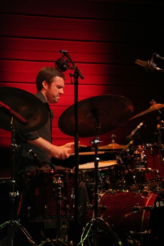 Andrew Barker playing drums with Daniel Carter and Sabir Mateen