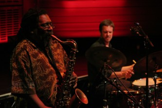 Sabir Mateen playing saxophone Andrew Barker playing drums