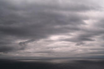 A sea view from Lyness Oil Tank, very grey, metallic