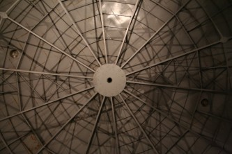 Circular roof of the Oil Tank with many metal spars and triangles