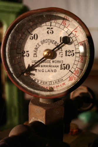 An old pressure gauge with imperial and metric measurements