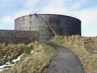 path towards Lyness Oil Tank with grass and snow on either side