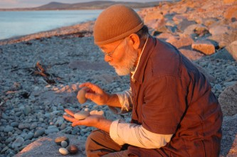 Akio Suzuki trying out stones from the beach outside Tugnet Ice House