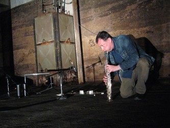 John Butcher blowing a soprano saxophone inside Wormit Reservoir