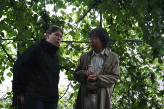 Bryony and Tamio looking wistful near a tree