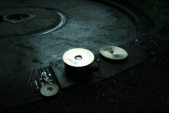 Sean's forks, cymbals, sticks etc on a stone floor