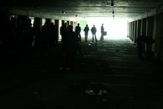 An underpass in Cumbernauld with an audience, light at one end