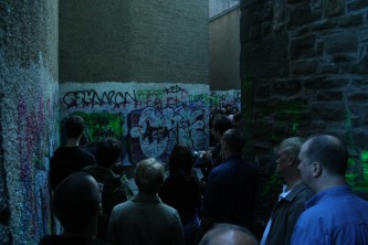 Backstreet of Dundee with an audience in a confined space