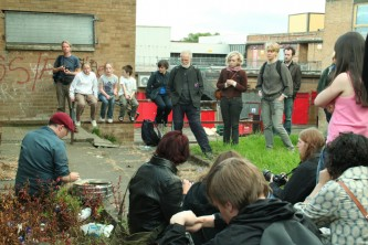 Sean Meehan surrounded by audience in Easterhouse