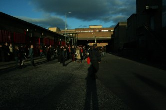 Easterhouse in late evening with a departing audience