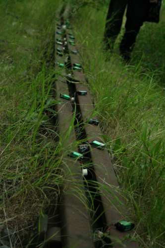 Ikuru Takehashi's small devices laid out on a railway track
