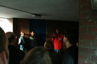 Denis Wood talking to an audience in a low ceiling space