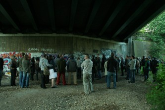 An audience under a bridge somewhere in newcastle
