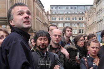 Neil Gray talks about gentrification in Glasgow surrounded by people