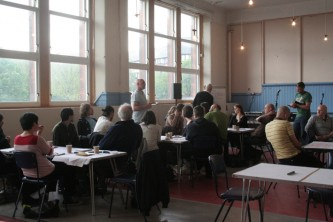 People sat at tables in Kinning Park Complex community centre