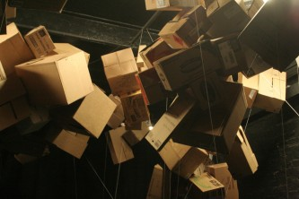 Suspended Cardboard boxes in a theatre space