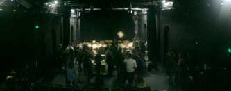 wide angle shot of theatre space with audience and many many boxes