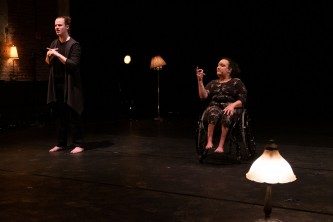 NEVE sits in a manual wheelchair, ASL interpreter is Patrick to their right