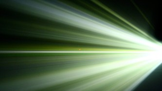 Beams of light fanning out from the right in bands of green and white