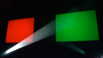 A rectangle of red light, one of green light and a beam of white light