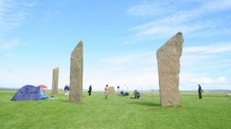 Stones of Stenness on Orkney with microphones and musicians between them