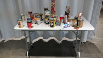 A table with various cans and jars of food