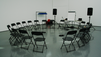 A circle of chairs in a room