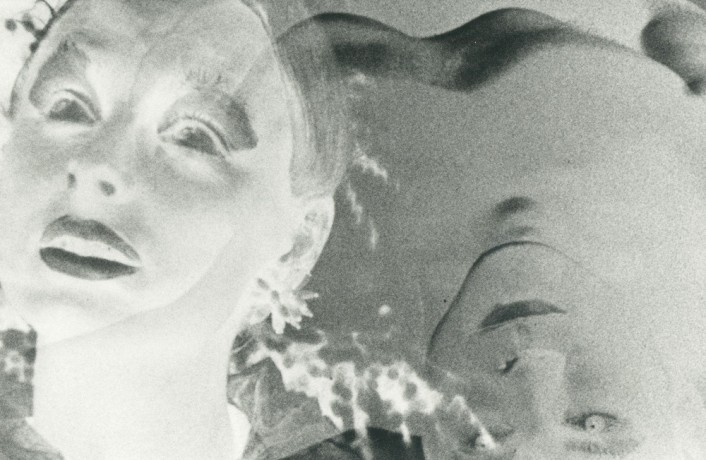Two figures in negative black and white