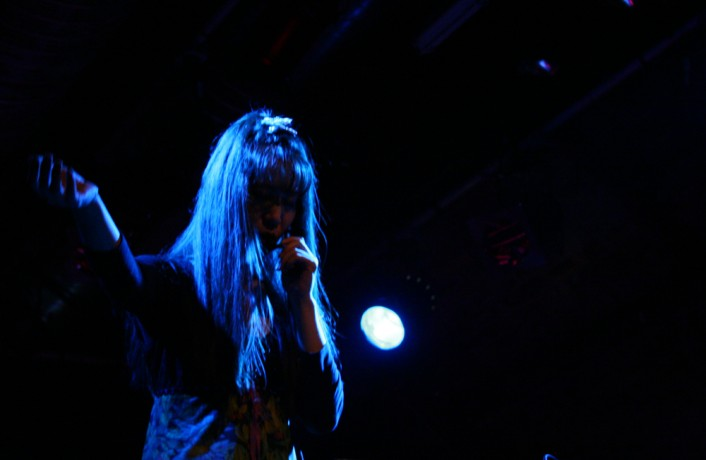 Sachiko performing in blue light at INSTAL 06