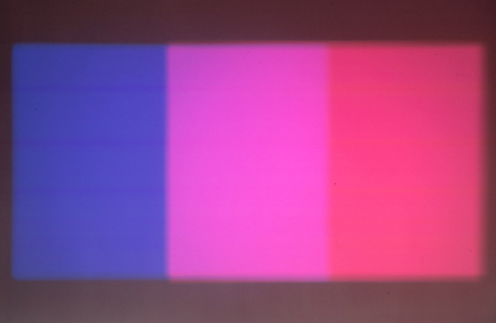 Paul Sharits' Shutter Interface projected on a wall: three bands of colour