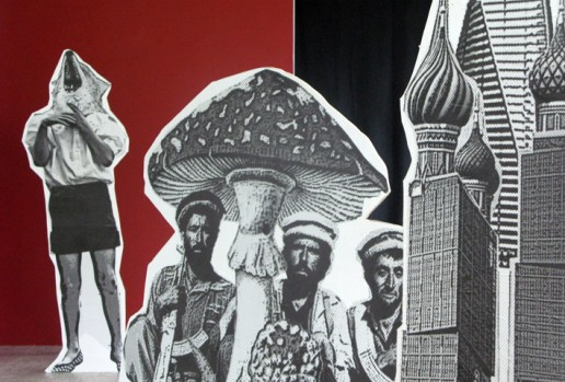 B&W cutout props of a large mushroom, some Russian building and 3 men