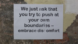 Sign: we just ask that you try to push at your own boundaries embrace discomfort