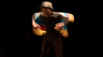 Storyboard P blurred in movement surrounded by darkness