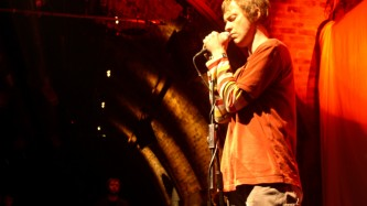 Richard Youngs standing with a microphone at INSTAL 04