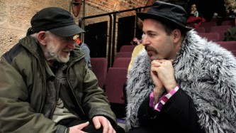 Gustav Metzger in a green jacket and Kenneth Goldsmith in a furry one chat