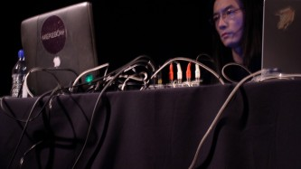 Merzbow: Masami Akita looking at a computer screen