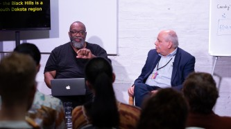 Fred Moten in the middle of speaking, with Fernando Zalamea listening beside