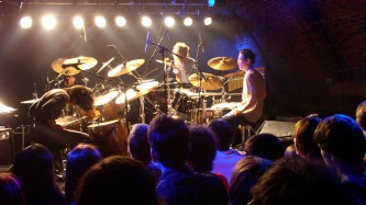 V∞redoms on stage at INSTAL 03 amidst at least three drum kits