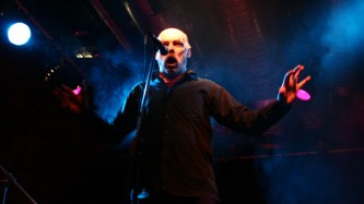 Ludo bellowing into a microphone at INSTAL 06