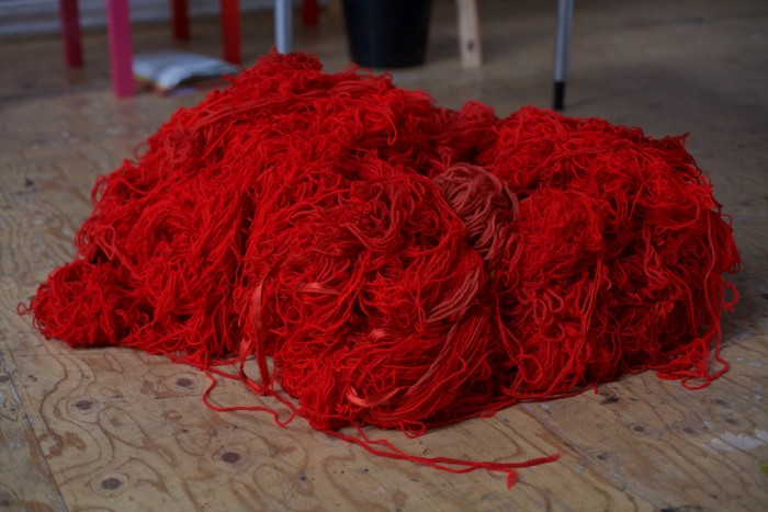 A huge pile of red wool