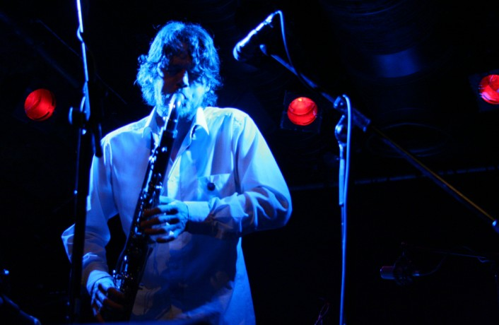 Arrington plays a bass clarinet in blue light at INSTAL 06