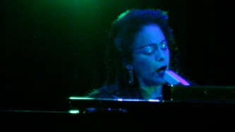 Diamanda Galas singing at a piano on stage at MLFC 07